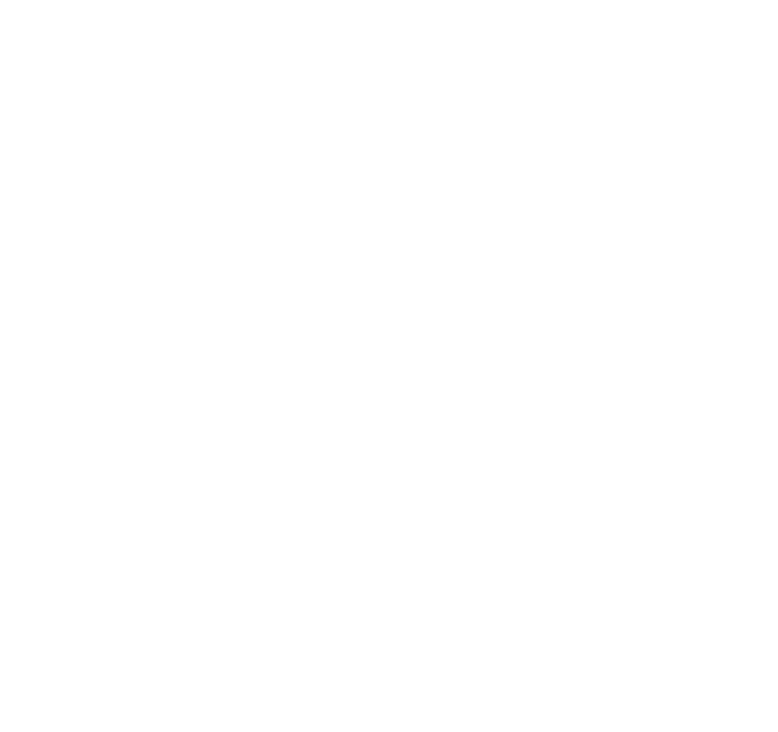 White icon of a cow in front of a barn eating grass